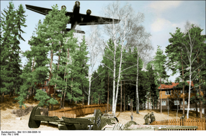 Messerschmitt Bf 110 of future night fighter ace Lt. Helmut Lent overshoot the runway in Oslo-Fornebu and came to rest in the garden of a house. A Junkers Ju 52/3m plane flies over the location. The photo has been taken by war reporters of the 5th Luftwaffe in Oslo1940.Photo: Pilz CC BY-SA 4.0