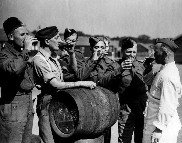 British troops released from a German prison camp in 1944 drinking English beer for the first time in four years.