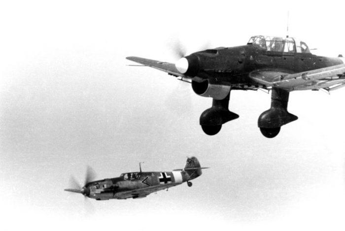 A Messerschmitt Bf 109 and a Ju 87 fly over the Mediterranean. Credit: Billhardt CC BY-SA 3.0