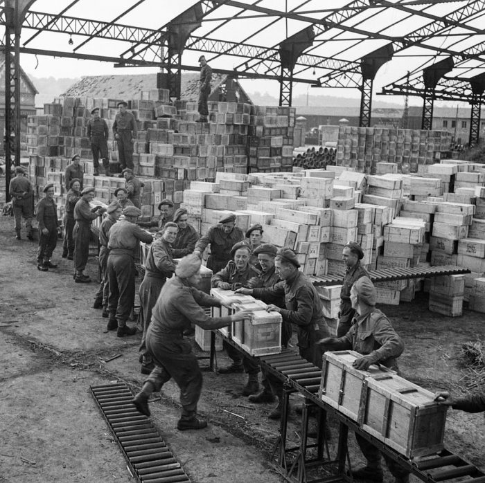 Troops from the Royal Army Service Corp handle ration boxes in the harbour at Dieppe in October 1944.