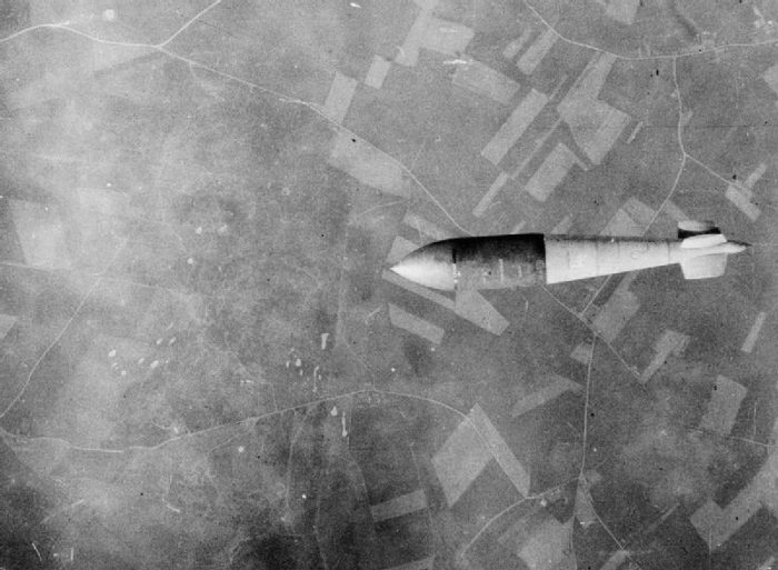 A 6.4 metre Tall Boy as its released from a Lancaster bomber over a V-2 rocket launch site.
