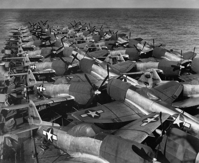 A deckload of U.S. Army Air Force Republic P-47N Thunderbolt fighters on the flight deck of the escort carrier USS Casablanca (CVE-55) in 16 July 1945. The planes were loaded at Naval Air Station Alameda, California (USA) and were bound for Guam.