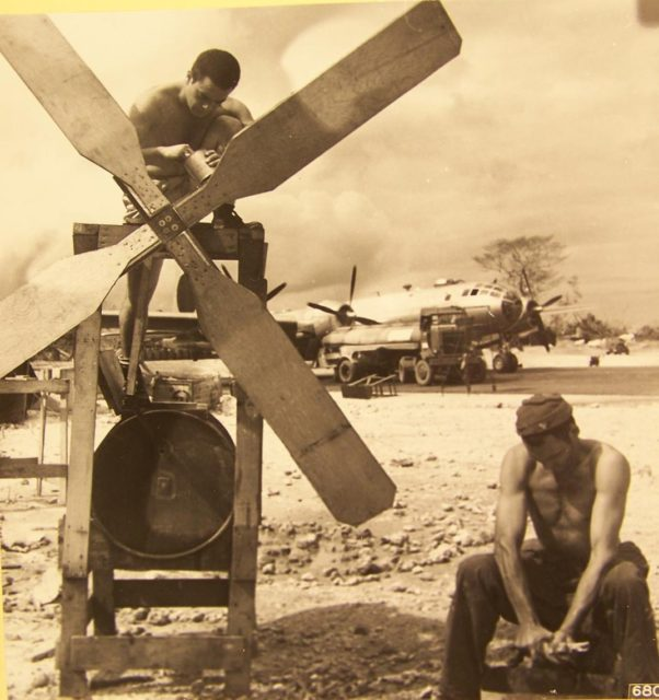 On wash day at North Field on Guam, Marianas Islands. A homemade washing machine is driven by a rotating propeller. (NARA)