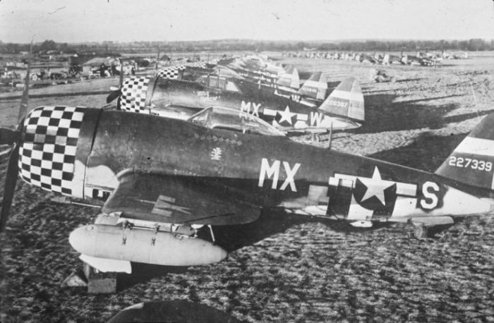 A line of 82nd Fighter Squadron, 78th Fighter Group P-47 Thunderbolts at Duxford airbase.