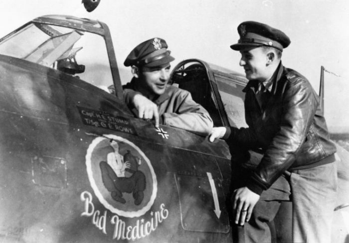 """Captain Harold E. Stump and Second Lieutenant George J. Hays of the 78th Fighter Group with a P-47 Thunderbolt nicknamed """"Bad Medicine"""", 15 October 1943"""