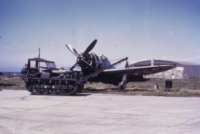 Cletrac in front of a P-47 Thunderbolt of the 406th Fighter Group.