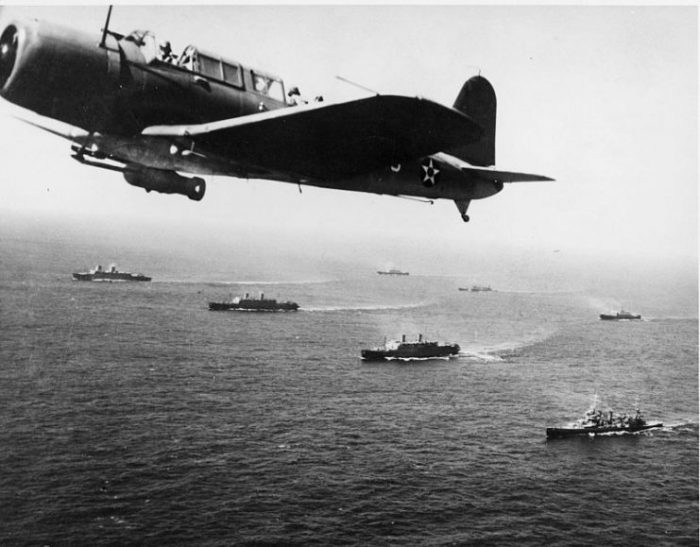 Convoy WS-12- A Vought SB2U Vindicator scout bomber from USS Ranger (CV-4) flies anti-submarine patrol over the convoy, while it was en route to Cape Town, South Africa, 27 November 1941.