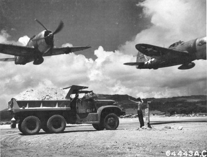 P-47 Thunderbolts from the 318th Fighter Group taking off from East Field on Saipan, Marianas Islands in October 1944.