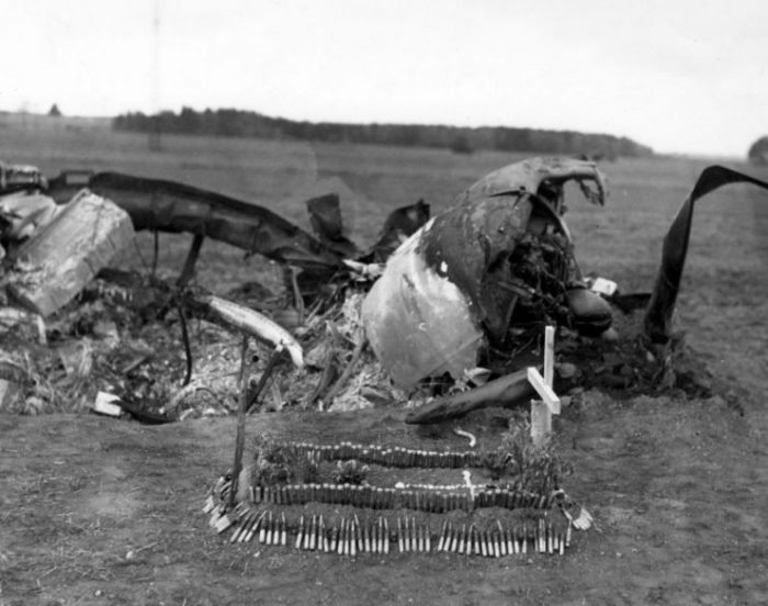When a squadron of P-47 Thunderbolts attacked a gunpowder storage depot, the ensuing explosion destroyed one of their aircraft. The grave for the pilot was made by a refugee French couple, with .50cal ammunition for a border.