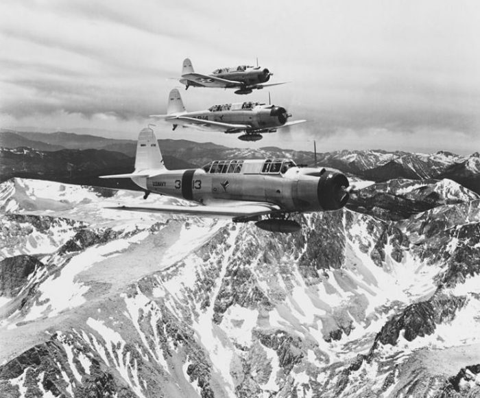 "Three U.S. Navy Vought SB2U-1 Vindicator aircraft (BuNo 0739, 0740, 0741) of Bombing Squadron 3 (VB-3) ""Tophatters"" in flight over the Sierra Nevada range near Mount Whitney on 11 July 1938."