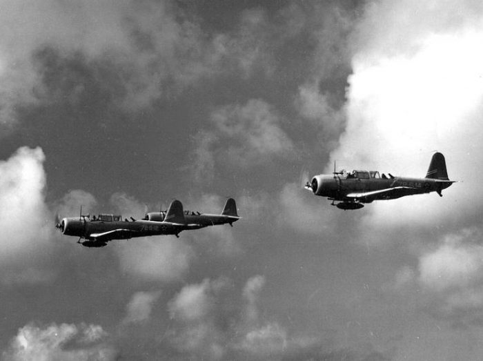 Three U.S. Navy Vought SB2U Vindicators from Scouting Squadron 72 (VS-72) from the USS Wasp (CV-7) in flight over water on 4 December 1941.