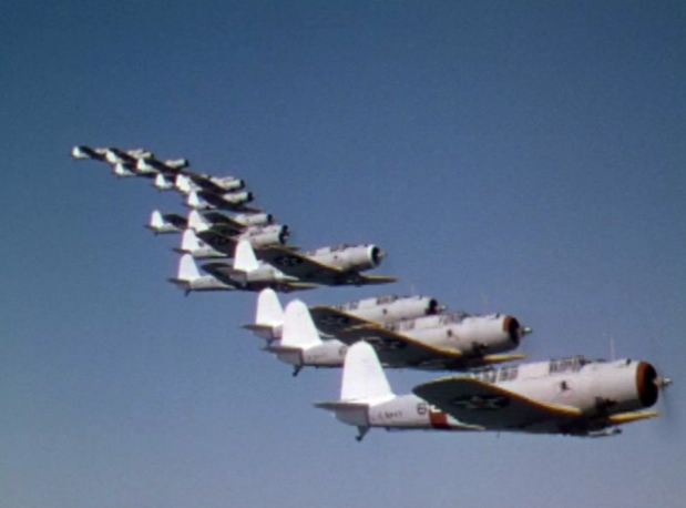 U.S. Navy Vought SB2U Vindicator dive bombers of Bombing Squadron VB-4 High Hatters in formation during the movie Dive Bomber (1941).