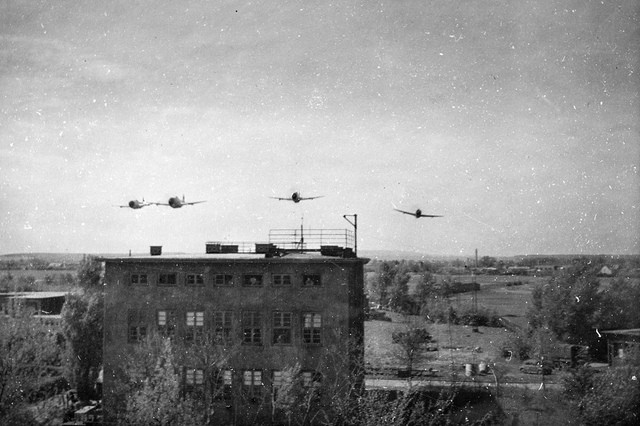 1945 World War II photo of American Republic P-47 Thunderbolts buzzing American troops in Brunswick, Germany