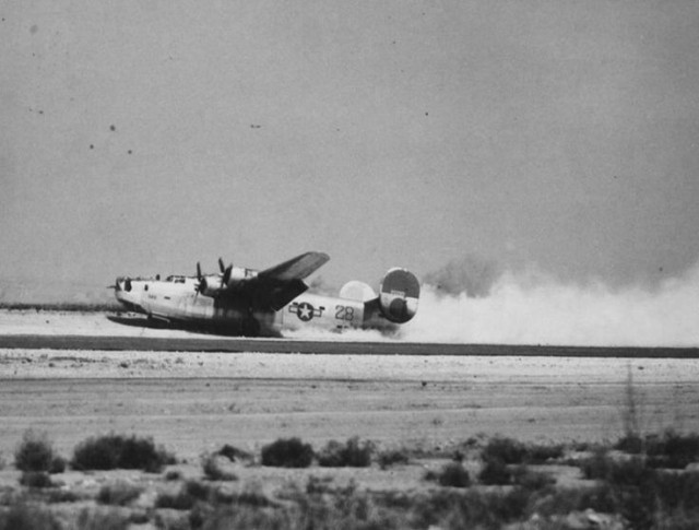 """""""T'ings Is Tuff"""", the Douglas-Tulsa-built Consolidated B-24H-15-DT Liberator, s/n 41-28931, 724th Bomb Squadron, 451st Bomb Group, 15th Air Force making a belly-landing at its base in Apulia Southern Italy after being damaged by Flak on a mission to Ploesti/Romania"""