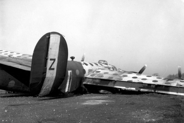 458th Bomb Group B-24 Liberator crash. This is an assembly ship. These planes were painted bright colors to assist in assembling the large bomber formations.
