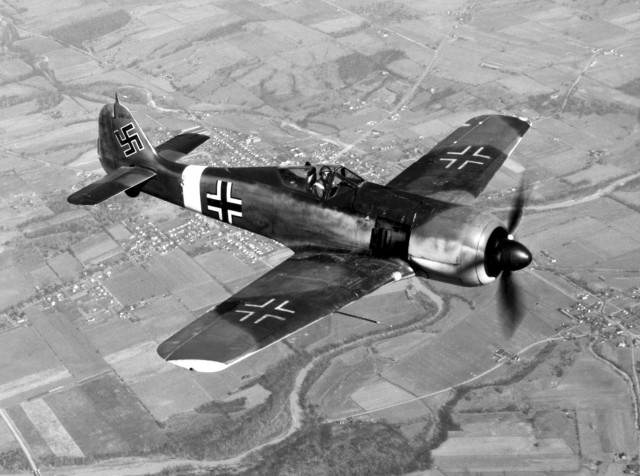 A captured Fw 190A-4. The USAAF-painted Balkenkreuz and swastika markings are of nonstandard size and proportions