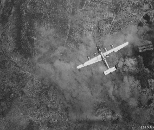 A damaged B-24 Liberator from the 376th American bombardment in flight over Toulon 1944.