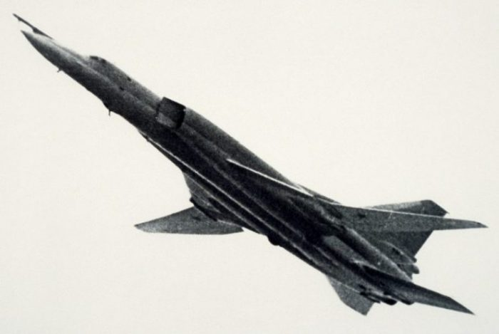 A left side view of a Soviet Tu-22M Backfire aircraft climbing after takeoff.