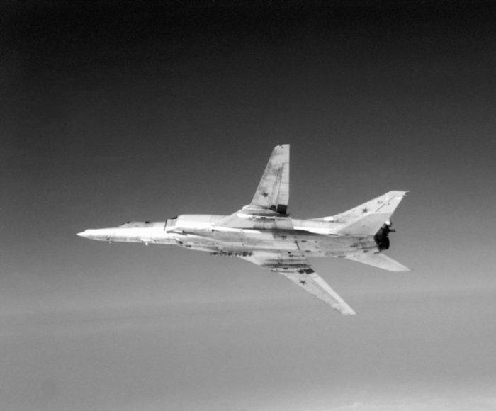 A left underside view of a Soviet Tu-22M Backfire-B bomber aircraft in flight.