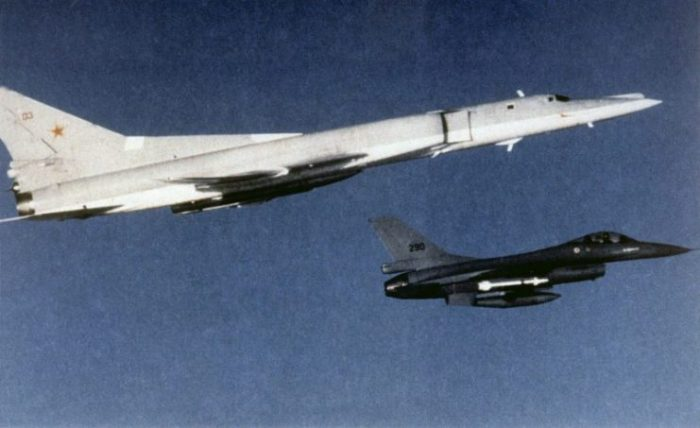 A Royal Norwegian Air Force General Dynamics F-16A Fighting Falcon aircraft escorting a Soviet Tupolev Tu-22M bomber.