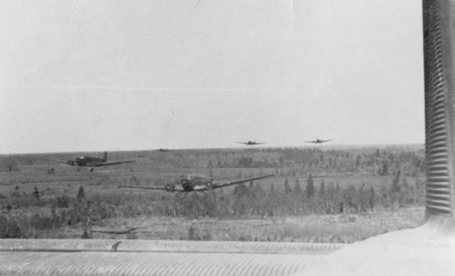 A squadron of Luftwaffe Ju-52 Junkers stream low over the Russian countryside near Demjansk, south of Leningrad.