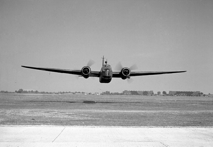 A Vickers Wellington I medium bomber is about to scare the bejeesus out of this RAF photographer at RAF Bassingbourn, in 1940