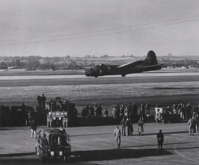 B-17F Fortress aircraft of the 91st BG, 8th Air Force executing a low fly-over during a demonstration at Bassingbourn, England, United Kingdom, 1943