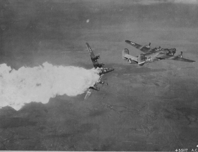 B-24 hit by FLAK and explodes in mid air