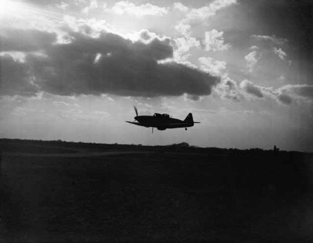 Boulton Paul Defiant Mark I night-fighter of No. 264 Squadron RAF, silhouetted against the clouds during a low-level pass over its base at Biggin Hill, Kent.