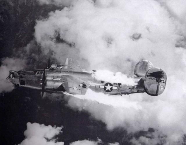 Fire spreads rapidly across a damaged B-24