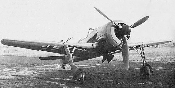 Fw 190 V5k. This is the V5 with the original small wing. The 12-blade cooling fan and redesigned undercarriage and canopy fairings are visible.