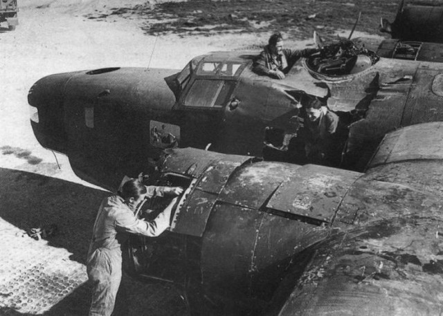 Inspection of a damaged B-24 after being hit by the 1000-pound bombs. March 14, 1945