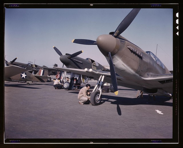 P-51 Mustang fighter planes being prepared for test flight at the field of the North American Aviation, Inc., plant in Inglewood, California.