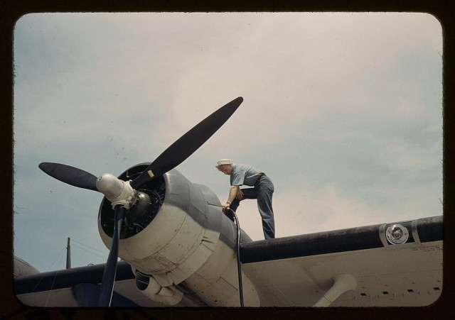 Sailor mechanic fuelling a plane at the Naval Air Base, Corpus Christi, Texas.