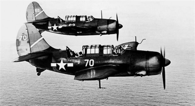 Curtiss SB2C Helldiver dive bombers in flight in 1943.