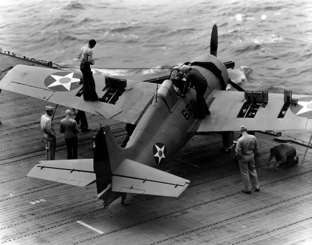Grumman F4F-4 Wildcat fighter, of Fighting Squadron Six (VF-6) has its six .50 caliber machine guns tested on the flight deck of USS Enterprise (CV-6), 10 April 1942. Note open gun bays in the plane's wings.