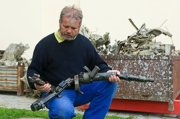 Tomáš Fedra of the Museum of Jindřichův Hrade holding parts of the wreckage. Image by CTK.