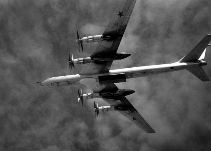 "Underside of a Soviet Tu-95 ""Bear F"" with an open weapons bay over the Pacific in 1987."
