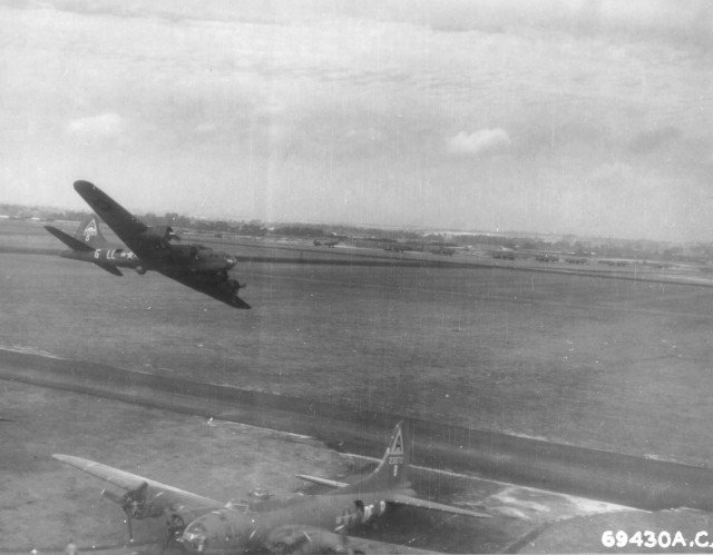 US B-17F Fortress aircraft 'Hell Belle' of the 91st Bomb Group, 401st Bomb Squadron doing a low-level fly-by at RAF Bassingbourn, England, United Kingdom, Jun-Sep 1943