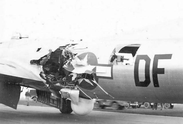 B-17 91 Bomb Group 324 Bomb Squadron with heavy flak damage.