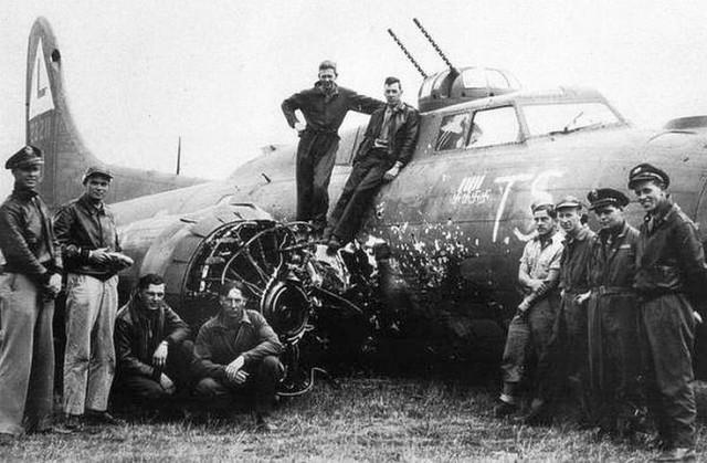 B-17 damaged in collision with Fw190 in head-on attack.