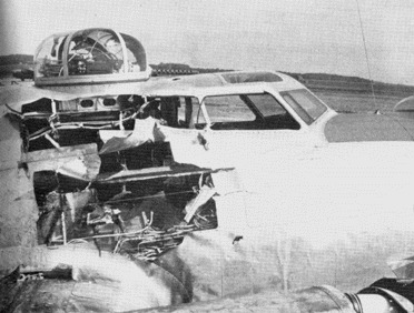 """A ground-launched rocket missile caused this damage to 388BG's """"Panhandle"""" during an attack on a V-weapon site, June 15, 1944. The missile struck number 3 engine, ricocheted into the fuselage and exploded, leaving Sgt Biggs, the top turret gunner, with nasty burns. Despite extensive damage to various control lines, Lt McFarlane brought the bomber down safely at Manston."""