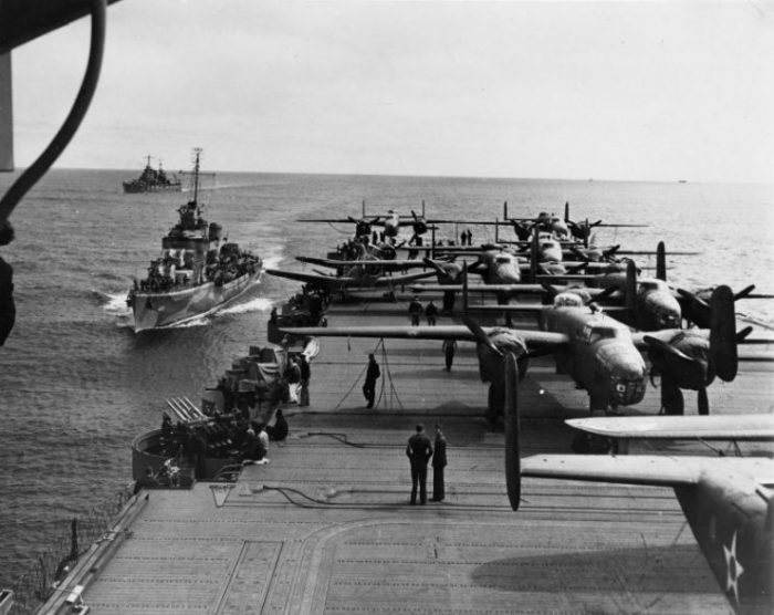 Aft flight deck of USS Hornet while en route to the launching point of the Doolittle Raid, April 1942. Note USS Gwin and USS Nashville nearby.