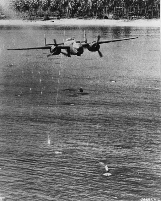 """B-25 Mitchell bomber of the 405th Bomb Squadron """"Green Dragons"""" employing the skip-bombing technique against enemy shipping. Southwest Pacific, 1944-45."""