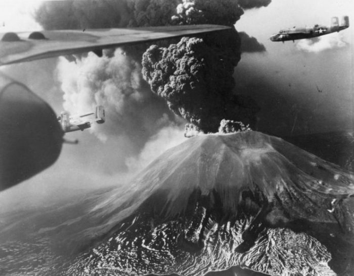 B-25 Mitchell bombers of 321st Bomber Group, US 447th Bomber Squadron flying past Mount Vesuvius, Italy during its eruption of 18-23 March 1944.