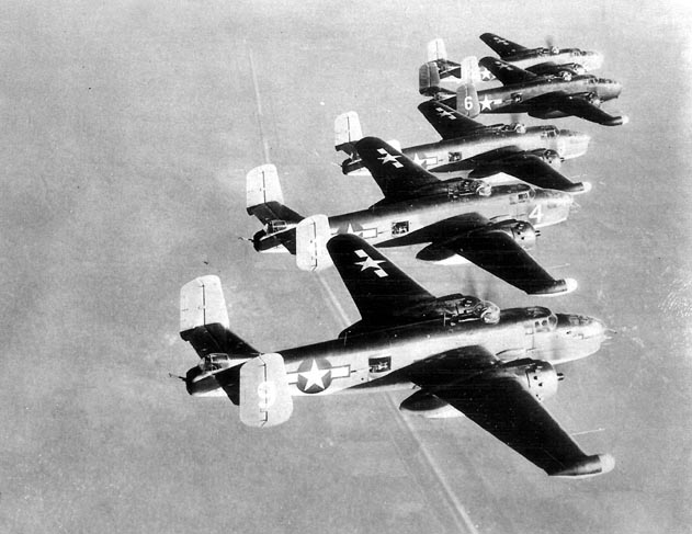 Five PBJ-1J Mitchells of Marine Squadron VMB-614 in a training flight over an undisclosed location in the US, 1944-1945. Note radomes on starboard wingtips.