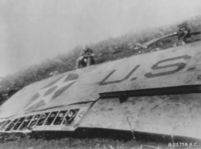 James Doolittle sitting by the wing of his wrecked B-25 Mitchell bomber, China, 18 April 1942.