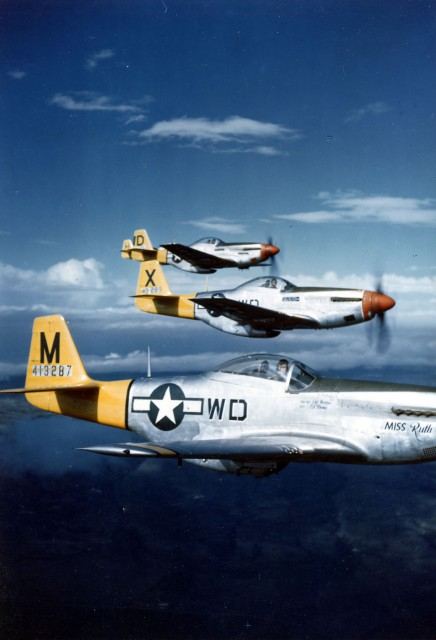 P-51D Mustangs of the 4th Fighter Squadron in flight, Italy, 1944
