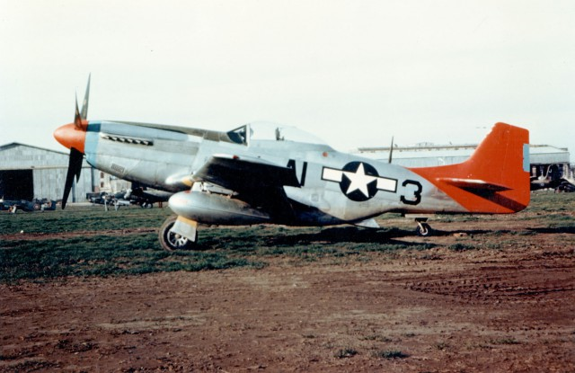 P-51D of the 99th Fighter Squadron, 332nd Fighter Group shows off it distinctive red tail, probably at Ramitelli Airfield, Italy, 1944-45.