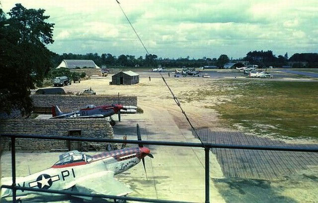 View from the control tower at Martlesham Heath, Suffolk, England, UK, of P-51D Mustangs of the 360th Fighter Squadron in sandbag revetments, 1944.